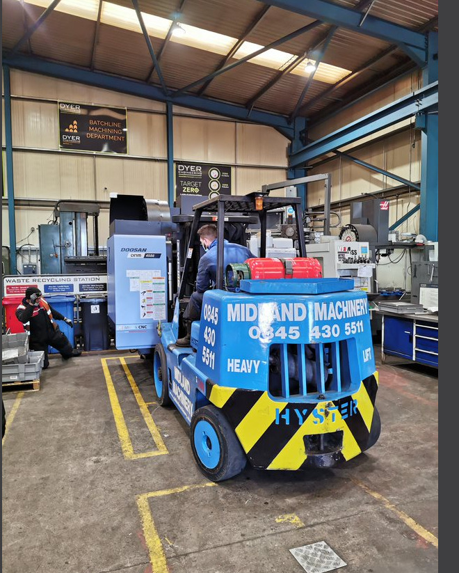 New state-of-the-art CNC machine being unloaded at dyer engineering